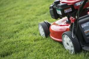 young man mowing the grass on a property tending royalty free image 158412502 1550759945 1